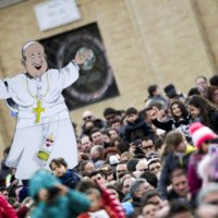 Pilgrim holds a cut-out of Pope Francis during Angelus at Vatican