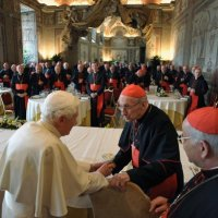 Pope Benedict XVI shakes hand with French Cardinal Etchegaray during a lunch offered to the cardinals to mark his fifth anniversary of pontificate at the Vatican